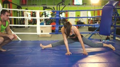 Young woman training pre-match warm-up in the boxing ring with her trainer Stock Footage