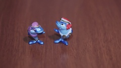 Toy two blue dolphins on a dark background cartoon mini Stock Footage