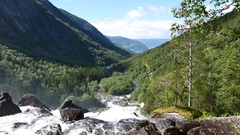 Big Waterfall at mountain river in summer Norway Stock Footage