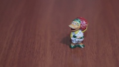 Duck toy housewife on a dark background Stock Footage