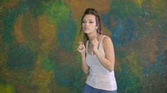 Beautiful young girl dancing. He listens to music on headphones. Very nice moves Stock Footage