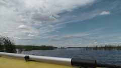 Big river to the horizon. Aboard of inflatable boat paddle in the foregroundе Stock Footage