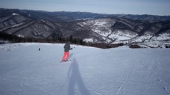 Rear View of Professional Skier Carving Down the Snowy Slope Stock Footage