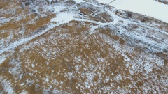 The pipes of the factory above frozen river. Stock Footage