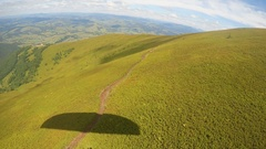 Paragliding view over green mountains. Carpathians Stock Footage