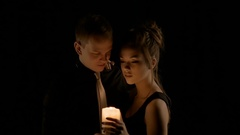 A loving couple, holding a candle, tenderly looking at each other. Valentine's Stock Footage