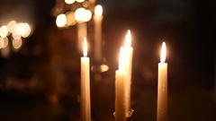 Candle burning in the candlestick Stock Footage