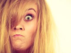 Furiously mad angry blonde woman closeup Stock Photos