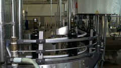 Glass bottle sorting production line in action at modern day wine factory. Stock Footage