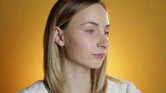 Closeup portrait of beautiful woman applying cream to face skincare concept Stock Footage