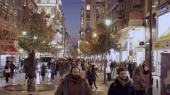 4K  dolly shot shoppers on Ermou str Athens,Greece, at dusk Stock Footage