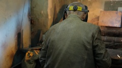In the closed workshop welder does the job in a protective mask Stock Footage