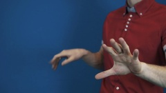 Close up magician in red shirt perform magic trick disappear in hands cigarette Stock Footage