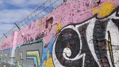 Graffiti Art Barbed Razor Wire Wall Tagging Gangs  4k Stock Footage