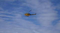 Ventura County Fire Helicopter Blue Sky Wispy Clouds Searching 4k Stock Footage
