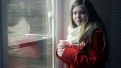 Young upset girl remembering ex-boyfriend and drinking tea Stock Footage