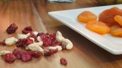 Dried fruits and nuts lying on the plate Stock Footage