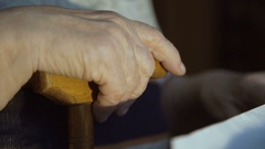 Old hands and stick. The old hands grandmother 4k Stock Footage