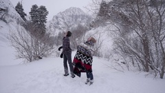 Cute Couple Stand Still And Try To Catch Snowflakes On Tongues In Mountains Stock Footage
