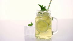 Green tea with citrus on a white background. Stock Footage
