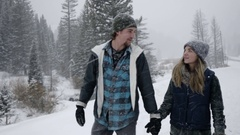 Couple Hold Hands And Snowshoe On Snowy Winter Day In Utah Mountains Stock Footage