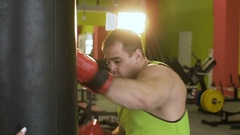 Slow motion of young boxer man practicing on a punching bag Stock Footage