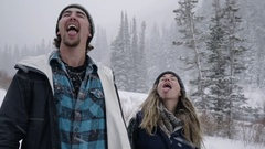 Closeup Of Cute Couple Catching Snowflakes On Their Tongues, In Utah Mountains Stock Footage