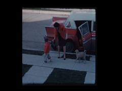 Little boy gets out of antique car trips and falls down Stock Footage