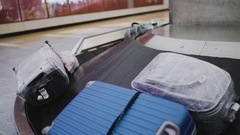 Luggage on conveyor belt in airport. UHD 4K Stock Footage