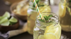 Green tea with citrus in drinking mason jar with ice. Stock Footage