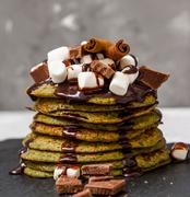 Non-traditional green sweet pancakes with chocolate Stock Photos