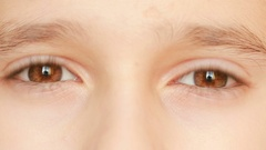 Little child's eyes, innocence, eyeballs, front view. close-up, a nervous tic Stock Footage