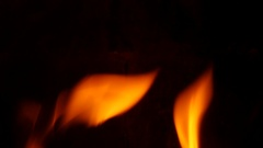 Close up of fire burning in stove slowmotion 96 frames per second Stock Footage