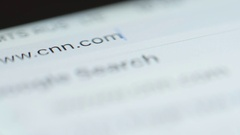 MACRO: Typing CNN domain in browser bar Stock Footage