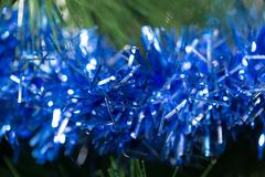 Blue tinsel for the New Year Stock Photos