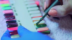 Choice of a varnish. A palette with different flowers of a varnish. Beautiful Stock Footage