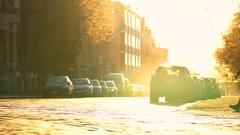 Woman cross shining road under the bright sun Stock Footage