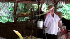Squeezing  sugarcane juice by the manual press. Vinales, Cuba Stock Footage
