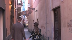 Couple walking on the old streets Stock Footage