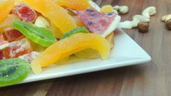 Plate of candied fruit kiwi, orange, watermelon, mango and pineapple Stock Footage