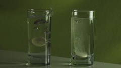 Tablet dissolves in glass of water slow motion stock footage video Stock Footage