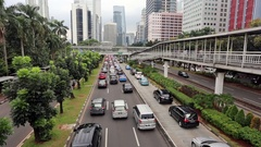 Traffic congestion in Jakarta modern financial district in Indonesia Stock Footage