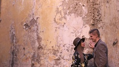 A couple talking on the background of the old wall Stock Footage
