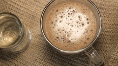 Glass cup of cappuccino and a glass of water Stock Footage