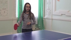 Beautiful young girl plays table tennis stock footage video Stock Footage