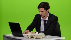 Office manager loaded errands on work, man unhappy. Green screen Stock Footage
