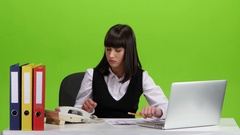 Angry phone conversation between the girl and her subordinate. Studio Stock Footage