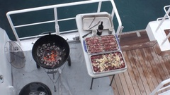 BBQ on the ship overlooking the water in Iceland. Cook prepares barbecue. Stock Footage