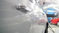 Door handle of the car - automobiles stands in garage, slider Stock Footage