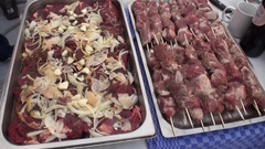 Raw meat for barbecue on a baking sheet. Close-up. Stock Footage